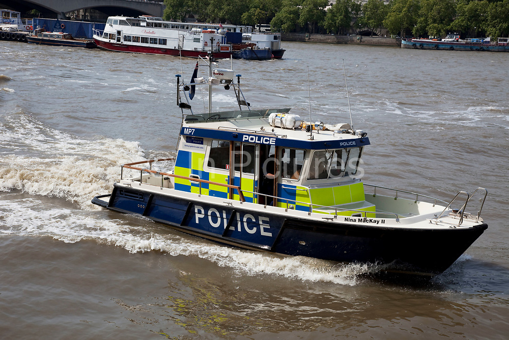 River Police boat patrolling on the River Thames, London. The Marine Police Force, sometimes known as the Thames River Police and said to be England's first Police force, was formed by magistrate Patrick Colquhoun and a Master Mariner, John Harriott, in 1798 to tackle theft and looting from ships anchored in the Pool of London and the lower reaches of the river. Its base was (and remains) in Wapping High Street, and it is now known as the Metropolitan Police Marine Policing Unit.