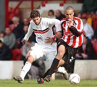 Photo: Daniel Hambury.<br /> Brentford V Bristol City.<br /> Coca Cola League One.<br /> 09/04/2005.<br /> Brentford's Darren Pratley and Bristol City's Tommy Doherty battle for the ball.