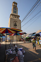 Chatuchak Clocktower -Chatuchak Market or sometimes written Jatujak or Weekend Market in Bangkok is the largest market in Thailand, and one of the largest of the world. Frequently called J.J. it covers over 35 acres and contains more than 5,000 stalls not counting wandering vendors and street entertainers. It is estimated that the market receives between 200,000 and 300,000 visitors each day. Most stalls are only open on Saturdays and Sundays. The market offers a wide variety of products including household items, clothing, Thai handicrafts, religious artifacts, collectibles, foods, and even live animals.