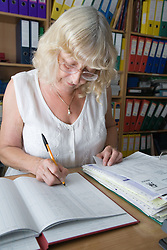 Woman checking invoices,