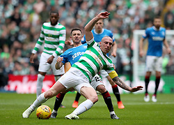 Celtic's Scott Brown and Rangers' Jason Holt battle for ball during the Ladbrokes Scottish Premiership match at Celtic Park, Glasgow.