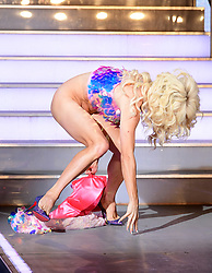 ***EDITS NOTE NUDITY*** Courtney Act enters the house during the Celebrity Big Brother Men's Launch held at Elstree Studios in Borehamwood, Hertfordshire.