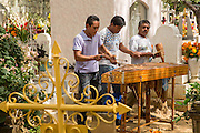 A traditional band plays at the San Miguel cemetery during the Day of the Dead Festival known in spanish as Día de Muertos on November 2, 2013 in Oaxaca, Mexico.