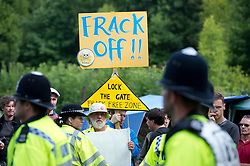 © London News Pictures.  27/07/2013. Balcombe, UK.  Anti Fracking activists and local villagers attempt to blockade a drilling site in Balcombe, West Sussex which has been earmarked for fracking. A number of demonstrators at the site have been arrested. Photo credit: Ben Cawthra/LNP