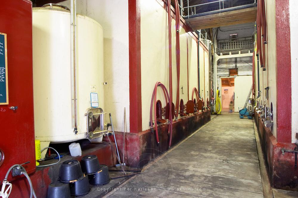 Domaine Le Nouveau Monde. Terrasses de Beziers. Languedoc. Painted steel vats. Concrete fermentation and storage vats. France. Europe.