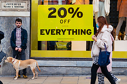 Edinburgh, Scotland, UK. 14 November 2020. Views of Edinburgh city centre on Saturday afternoon during a level 3 lockdown imposed by the Scottish Government;.Pictured;  Sales are on in most shops on Princes Street. Iain Masterton/Alamy Live News.