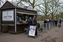 © Licensed to London News Pictures. 19/02/2021. London, UK. Members of the public queue at the Park View Coffee Cabin in a busy Greenwich Park in South East London. A national lockdown is in place in England to attempt to reduce the spread of a new strain of COVID-19 . Photo credit: George Cracknell Wright/LNP