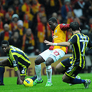 Galatasaray's Emmanuel Eboue (C) during their Turkish superleague soccer derby match Galatasaray between Fenerbahce at the TT Arena in Istanbul Turkey on Friday, 18 March 2011. Photo by TURKPIX