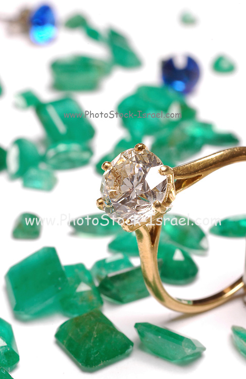 Diamond engagement ring with jades gemstones as background