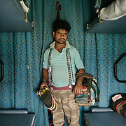 Peddler selling Chains to lock up your bag.<br /> Life on the longest train ride in India, between Kanyakumari and Dibrugarh city.