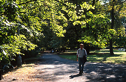 CZECH REPUBLIC BOHEMIA PRAGUE JUL97 - A man walks on Strelecky island in Prague.  . . jre/Photo by Jiri Rezac. . © Jiri Rezac 1997. . Tel:   +44 (0) 7050 110 417. Email: jiri@jirirezac.com. Web:   www.jirirezac.com