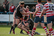 Scott Moore (Bradford Bulls) and James Bentley (Bradford Bulls) stop Liam Bent (Oldham Roughyeds) during the Kingstone Press Championship match between Oldham Roughyeds and Bradford Bulls at Bower Fold, Oldham, United Kingdom on 2 April 2017. Photo by Mark P Doherty.