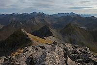 Rugged mountain landscape viewed from summit of Matmora mountain peak, Austvågøy, Lofoten Islands, Norway