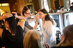 Models prepare backstage before the Julien Macdonald Autumn/Winter 2017 London Fashion Week show at Goldsmith's Hall, London.PRESS ASSOCIATION Photo. Picture date: Saturday February 18th, 2017. Photo credit should read: Matt Crossick/PA Wire.