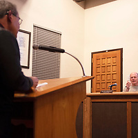 Business Improvement District Chair Louie Bonaguidi fields questions from City Councilor Allan Landavazo at a City Council meeting Tuesday, Dec. 10 in Gallup.