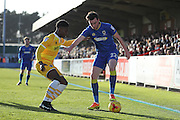 AFC Wimbledon defender Sean Kelly (22) and Millwall defender Shaun Cummins (2) battle for possession during the EFL Sky Bet League 1 match between AFC Wimbledon and Millwall at the Cherry Red Records Stadium, Kingston, England on 2 January 2017. Photo by Stuart Butcher.