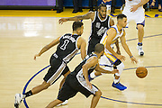Golden State Warriors guard Stephen Curry (30) is swarmed by the San Antonio Spurs at Oracle Arena in Oakland, Calif., on October 25, 2016. (Stan Olszewski/Special to S.F. Examiner)