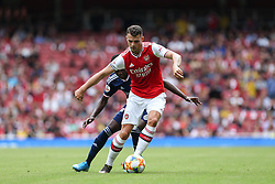 Granit Xhaka of Arsenal holds the ball up under pressure - Mandatory by-line: Arron Gent/JMP - 28/07/2019 - FOOTBALL - Emirates Stadium - London, England - Arsenal v Olympique Lyonnais - Emirates Cup