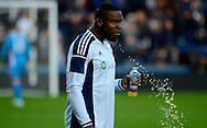 Stephane Sessegnon takes on liquid during the The FA Cup match between West Bromwich Albion and Gateshead at The Hawthorns, West Bromwich, England on 3 January 2015. Photo by Alan Franklin.