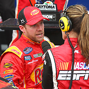 Regan Smith celebrates his victory during an ESPN interview after winning the NASCAR DRIVE4COPD 300 auto race at Daytona International Speedway on Saturday, February 22, 2014 in Daytona Beach, Florida.  (AP Photo/Alex Menendez)