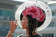 04/06/2010..Ladies Day at the Oaks meeting at Epsom racecourse, Surrey, Britain, 03 June 2010. .The Oaks Stakes is a Group 1 flat horse race for three-year-old thoroughbred fillies. It is run over a distance of 1 mile 4 furlongs and 10 yards (2,423 m) at Epsom Downs Racecourse always in early June. It is one of five British Classic Races...All Rights Reserved - Picture It Now - T: +44 (0) 2392 599 888.Local copyright law applies to all print & online usage. Fees charged will comply with standard space rates and usage for that country, region or state.