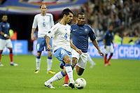FOOTBALL - UEFA EURO 2012 - QUALIFYING - GROUP D - FRANCE v BOSNIA - 11/10/2011 - PHOTO JEAN MARIE HERVIO / DPPI - EMIR SPAHIC (BOS) / FLORENT MALOUDA (FRA)