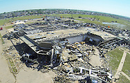 The Briarwood elementary school lies in ruins in Oklahoma City, Oklahoma May 22, 2013.  Dozens of teachers and children were in the school when the May 20, 2013 storm hit but all escaped with only minor injuries. Rescue workers with sniffer dogs picked through the ruins on Wednesday to ensure no survivors remained buried after a deadly tornado left thousands homeless and trying to salvage what was left of their belongings. Curvature of horizon in the photo is due to an ultra-wide angle lens.  REUTERS/Rick Wilking (UNITED STATES)