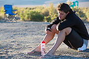 Jan Bos neemt wat tijd voor zichzelf met een iPhone na het rijden van zijn race op de vierde racedag van de WHPSC. In de buurt van Battle Mountain, Nevada, strijden van 10 tot en met 15 september 2012 verschillende teams om het wereldrecord fietsen tijdens de World Human Powered Speed Challenge. Het huidige record is 133 km/h.<br /> <br /> Jan Bos is relaxing with his iPhone after he raced on the fourth day of the WHPSC. Near Battle Mountain, Nevada, several teams are trying to set a new world record cycling at the World Human Powered Vehicle Speed Challenge from Sept. 10th till Sept. 15th. The current record is 133 km/h.