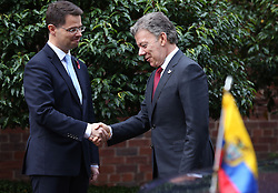 Colombia's president Juan Manuel Santos (right) greeted by Northern Ireland Secretary James Brokenshire on arrival at Stormont House, Belfast, during a state visit.