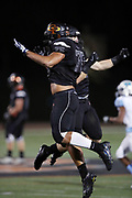 Erie Cathedral Prep Ramblers defensive lineman Fredrick Scruggs (75) and Ramblers linebacker Matthew Bauer (27) leap and celebrate during the 2017 high school football game against the against the Cleveland Benedictine Bengals, Friday, Sept. 15, 2017 in Erie, Pa. The Ramblers won the game 62-28. (©Paul Anthony Spinelli)