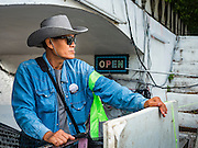 03 SEPTEMBER 2016 - BANGKOK, THAILAND:   Pom Mahakan residents guard a barricade to prevent Bangkok officials from demolishing their homes. Hundreds of people from the Pom Mahakan community and other communities in Bangkok barricaded themselves in the Pom Mahakan Fort to prevent Bangkok officials from tearing down the homes in the community Saturday. The city had issued eviction notices and said they would reclaim the land in the historic fort from the community. People prevented the city workers from getting into the fort. After negotiations with community leaders, Bangkok officials were allowed to tear down 12 homes that had either been abandoned or whose owners had agreed to move. The remaining 44 families who live in the fort have vowed to stay.    PHOTO BY JACK KURTZ