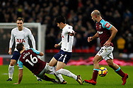 Mark Noble of West Ham United (L) tackles Son Heung-min of Tottenham Hotspur (c). Premier league match, Tottenham Hotspur v West Ham United at Wembley Stadium in London on Thursday  4th January 2018.<br /> pic by Steffan Bowen, Andrew Orchard sports photography.