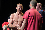 """Donald """"Cowboy"""" Cerrone exchanges words with his opponent, John """"The Bull"""" Makdessi, during the official UFC 187 weigh-in event at the MGM Grand in Las Vegas, Nevada on May 22, 2015. (Cooper Neill)"""