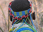 The back of a head of a Hadzabe man with traditional beads and headdress Photogrphed at Lake Eyasi, Tanzania