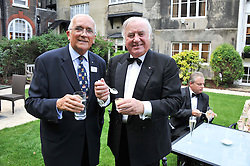 Left to right, DICK TURPIN and JIMMY TARBUCK at a reception hosted by the Friends of the Castle of Mey held at the Goring Hotel, Beeston Place, London on 22nd May 2012.