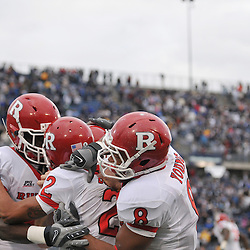 Oct 31, 2009; East Hartford, CT, USA; Rutgers wide receiver Tim Brown (2) celebrates his game winning touchdown with wide receiver Mark Harrison (81) and running back Kordell Young (8) during second half Big East NCAA football action in Rutgers' 28-24 victory over Connecticut at Rentschler Field.