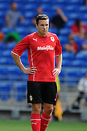 Don Cowie of Cardiff city in action. Pre season friendly match, Cardiff city v Athletic Club Bilbao at the Cardiff city stadium in Cardiff,  South Wales on Saturday 10th August 2013. pic by Andrew Orchard,  Andrew Orchard sports photography,