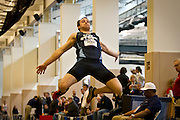 Wisconsin-Stout Hepthathlete Daniel Drewek fully extends during the long jump competition on Friday of the NCAA Division III Indoor Track and Field National Championships at Grinnell College.