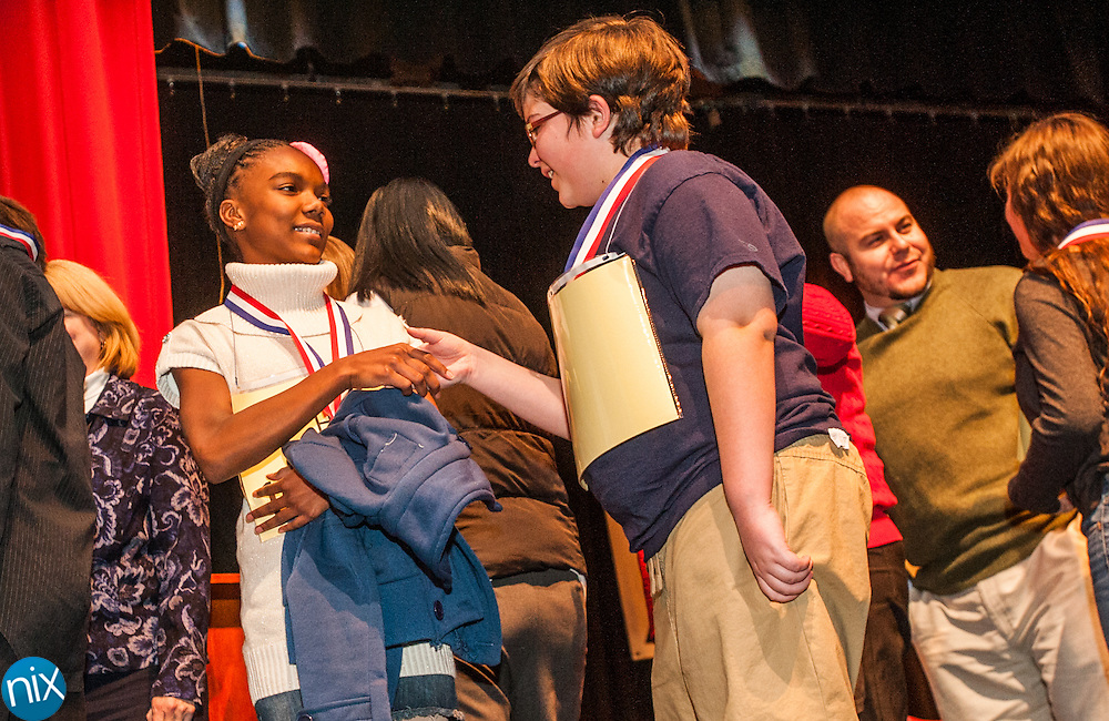 Joy Jackson, from Harris Road Middle School is congratulated by fellow speller Bryce Biehle, from J.N. Fries Magnet, after Jackson won the Cabarrus County Schools Spelling Bee Wednesday night at Winkler Middle School in Concord.