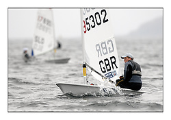 The second day of racing at the World Laser Radial Youth Championships, Largs, Scotland..Elliot Hanson GBR 195302.317 Youth Sailors from 42 different nations compete in the World and European Laser Radial Youth Champiponship from the 17-25 July 2010...The Laser Radial World Championships take place every year. This is the first time they have been held in Scotland and are part of the initiaitve to bring key world class events to Britain in the lead up to the 2012 Olympic Games. ..The Laser is the world's most popular singlehanded sailing dinghy and is sailed and raced worldwide. ..Further media information from .laserworlds@gmail.com.event press officer mobile +44 7866 571932 and +44 1475 675129 .