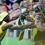 Athletics - Olympics: Day 9  Usain Bolt of Jamaica in the crowd as he celebrates after winning the Men's 100m Final at the Olympic Stadium on August 14, 2016 in Rio de Janeiro, Brazil. (Photo by Tim Clayton/Corbis via Getty Images)