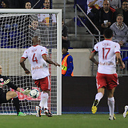 Marco Di Vaio, Montreal Impact, (right) beats New York Red Bulls goalkeeper Luis Robles at the near post to score a late goal during the New York Red Bulls V Montreal Impact, Major League Soccer regular season match at Red Bull Arena, Harrison, New Jersey. USA. 16th March 2013. Photo Tim Clayton