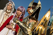"""Cosplayes dressed as """"the Pope"""" (L), """"Athena"""" (C) and """"Sagitarius"""" (R), characters from the action game """"SAINT SEIYA"""".  TOKYO COMIC MARKET """"COMIKET"""" the biggest comic market in Japan. Independent designers come to sell their comics, there is anime, manga, cosplay, toys, posters etc. At """"Tokyo Big Sight"""" exhibition center."""