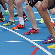 Athletes feet on the start line during competition at the 2013 NYC Mayor's Cup Outdoor Track and Field Championships at Icahn Stadium, Randall's Island, New York USA.13th April 2013 Photo Tim Clayton