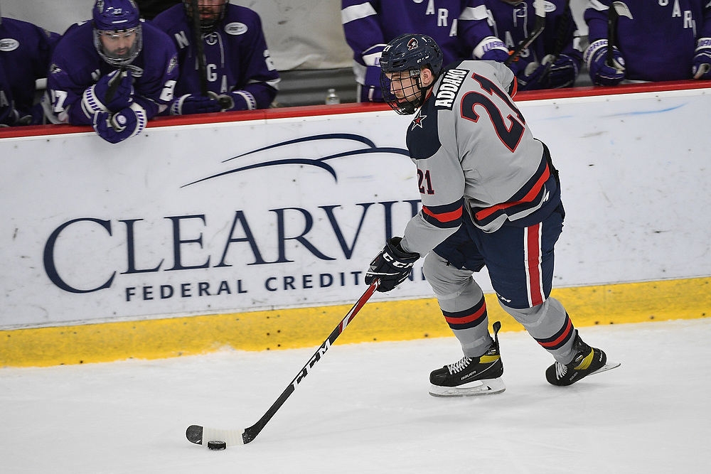 PITTSBURGH, PA - MARCH 14: Justin Addamo #21 of the Robert Morris Colonials skates with the puck in the third period during Game Three of the Atlantic Hockey Quarterfinal series against the Niagara Purple Eagles at Clearview Arena on March 14, 2021 in Pittsburgh, Pennsylvania. (Photo by Justin Berl/Robert Morris Athletics)