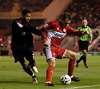 Photo: Jed Wee.<br /> Middlesbrough v Crystal Palace. Carling Cup. 30/11/2005.<br /> <br /> Middlesbrough's Szilard Nemeth (R) shields the ball from Palace's Jobi McAnuff.