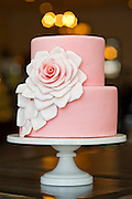 A pink fondant cake with a rose at Meridienne Dessert Salon and Cafe in Rogers, Arkansas.