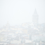 Galata Tower seen from Topkapi Palace through mist and rain. On a peninsula overlooking both the Bosphorus Strait and the Golden Horn, Topkapi Palace was the primary residence of the Ottoman sultans for approximately 400 years (1465–1856) of their 624-year reign over Constantinople and the Ottoman Empire. Today it is one of Istanbul's primary tourist attractions.