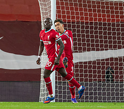 LIVERPOOL, ENGLAND - Sunday, December 27, 2020: Liverpool's Sadio Mané (L) celebrates with team-mate Roberto Firmino after scoring the first goal during the FA Premier League match between Liverpool FC and West Bromwich Albion FC at Anfield. The game ended in a 1-1 draw. (Pic by David Rawcliffe/Propaganda)