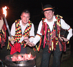 Grabbing a quick Warm before the start of the Wath Fire Festival are Wath Moris men Robert Lloyd and Nigel Tyas<br /><br />Sunday23-12-2001